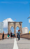 Brooklyn Bridge and People. New YORK CITY, USA - 1ST SEPTEMBER 2014: Brooklyn Bridge during the day showing people on the walkway bridge royalty free stock image