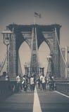 In the Brooklyn Bridge. People walking in the Brooklyn Bridge Stock Image