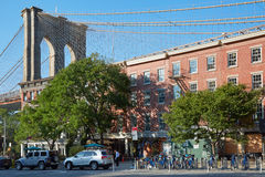 Brooklyn Bridge pillar with red bricks buildings facades Stock Photo