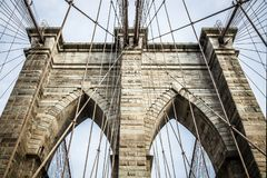 Brooklyn Bridge pylon structure. Made out of bricks during summer sunny day royalty free stock image