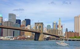 Brooklyn Bridge and Sailboat. Wide view of Brooklyn Bridge facing Manhattan with sailboat royalty free stock images