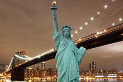 Brooklyn Bridge and The Statue of Liberty at Night Royalty Free Stock Image