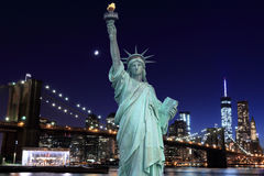 Brooklyn Bridge and The Statue of Liberty at Night Stock Images