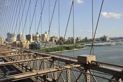 Brooklyn Bridge structure over East River of Manhattan from New York City in United States Stock Photography