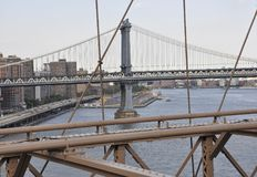 Brooklyn Bridge structure over East River of Manhattan from New York City in United States Royalty Free Stock Photos