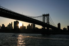 Brooklyn Bridge Sundown. Shot of the Brooklyn Bridge taken from a cruise ship as the sun set in late summer stock photo
