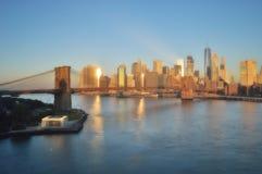 Brooklyn Bridge at sunrise. Manhattan skyline with Brooklyn Bridge at sunrise - soft focus image Royalty Free Stock Images