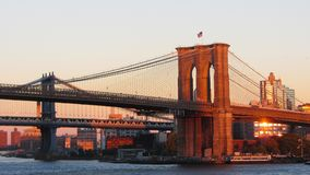 Brooklyn Bridge Sunset. This was taken during a trip to New York City. Brooklyn bridge with city background royalty free stock images