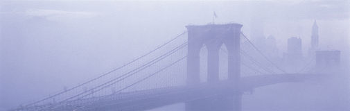 Brooklyn Bridge surrounded by fog Stock Photography