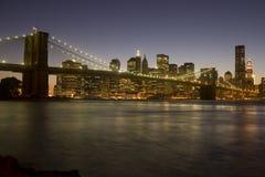 Brooklyn Bridge to Manhattan. The iconic Brooklyn Bridge and downtown New York City skyline at dusk royalty free stock photos