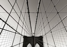 Brooklyn Bridge tower, in Black & White, with symmetrical suspension cables, New York City. Brooklyn Bridge towers, in Black & White, with double gothic arches Stock Photography