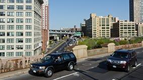 Brooklyn Bridge traffic. SUV Cars driving on the Brooklyn Bridge Stock Image