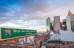Brooklyn Bridge traffic sign and Downtown Manhattan stock photography