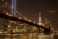 Brooklyn Bridge with The Tribute in Light. At night on September 11, 2014.  The Tribute in Light is an art installation of 88 searchlights placed next to the Royalty Free Stock Images