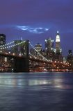 Brooklyn Bridge at twilight. Brooklyn Bridge and NYC at twilight Stock Photo
