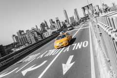 Brooklyn bridge with yellow fast taxi car on New York city NYC royalty free stock photo