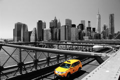 Brooklyn Bridge & Yellow Taxi Cab, New York, USA Royalty Free Stock Photography