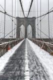 Brooklyn bro, snöstorm - New York City Fotografering för Bildbyråer