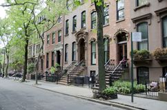 Brooklyn Brownstone. A row of brownstone homes on a quiet leafy street in the borough of Brooklyn in New York City stock photography