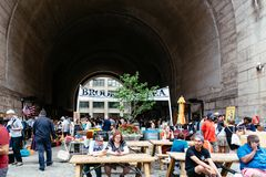 Brooklyn Flea Market in DUMBO in New York. New York City, USA - June 24, 2018: Brooklyn Flea Market in DUMBO. It includes vendors of furniture, vintage clothing royalty free stock photos