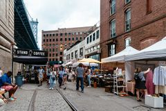 Brooklyn Flea Market in DUMBO in New York. New York City, USA - June 24, 2018: Brooklyn Flea Market in DUMBO. It includes vendors of furniture, vintage clothing stock photos