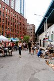 Brooklyn Flea Market in DUMBO in New York. New York City, USA - June 24, 2018: Brooklyn Flea Market in DUMBO. It includes vendors of furniture, vintage clothing stock photography