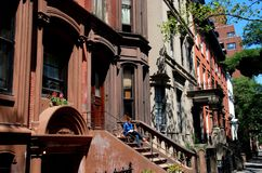 Brooklyn Heights, NY: 19th Century Brownstones. Handsome 19th century brownstones, many with high stoops, line the west side of Henry Street in the Brooklyn stock photo