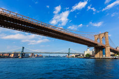 Brooklyn and Manhattan bridges East River NY Stock Images