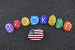 Brooklyn, the most populous borough of New York City celebrated with a colored stones composition over black sand stock photos