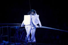 Astronaut dressed performers balance Simet Wheel during Ringling Stock Photography