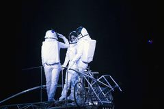 Astronaut dressed performers balance Simet Wheel during Ringling. BROOKLYN, NEW YORK - FEBRUARY 25: Laszlo Simet, his wife and partner dressed as astronauts Royalty Free Stock Photo