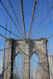 American flag on top of famous Brooklyn Bridge Royalty Free Stock Image