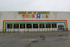 Going out of business sign on Toys R Us store. BROOKLYN, NEW YORK - MAY 18, 2018: Going out of business sign on Toys R Us store in Brooklyn, New York. Toys R Us Royalty Free Stock Photos