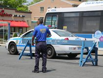 NYPD community affairs police officer provides security during Bay Fest street festival on Sheepshead Bay in Brooklyn. BROOKLYN, NEW YORK - MAY 20, 2018: NYPD stock photos