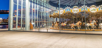 BROOKLYN, NY - JUNE 11, 2013: Historic Jane's Carousel at night. In Brooklyn, NY. This restored 1922 carousel is housed in the pavilion under Brooklyn Bridge Stock Photo