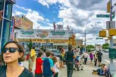 Brooklyn, NY / United States - June 15, 2018: A landscape of Nathan's in Coney Island on Stillwell Avenue royalty free stock image