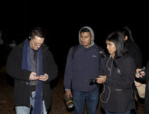 Brooklyn Paranormal Society during investigation. HUNTINGTON, NEW YORK, USA - NOVEMBER 14: Ron Yacovetti checks his audio recording device as other members of stock photography