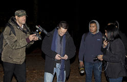 Brooklyn Paranormal Society during investigation. HUNTINGTON, NEW YORK, USA - NOVEMBER 14: Ron Yacovetti checks his audio recording device as other members of royalty free stock images