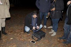 Brooklyn Paranormal Society during investigation. HUNTINGTON, NEW YORK, USA - NOVEMBER 14: Ron Yacovetti checks his audio recording device as other members of stock photos