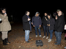 Brooklyn Paranormal Society during investigation. HUNTINGTON, NEW YORK, USA - NOVEMBER 14: Ron Yacovetti uses his audio recording device as other members of the stock photos