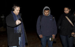 Brooklyn Paranormal Society during investigation. HUNTINGTON, NEW YORK, USA - NOVEMBER 14: Ron Yacovetti uses his audio recording device as other members of the stock images