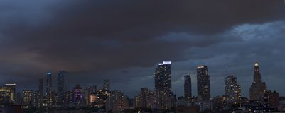 Brooklyn skyline at night under a storm stock photography