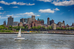 Brooklyn Skyline and river with sailboat Royalty Free Stock Photo