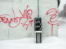 Brooklyn Snow. A partially buried payphone after a snowstorm in Brooklyn, N.Y Royalty Free Stock Images