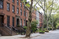 Brooklyn Street. A quiet tree lined street in Brooklyn in New York City with stately brick and brownstone homes royalty free stock photo