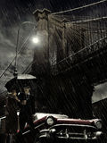 Brooklyn under rain. Couple taking a walk under the rain, close to the Brooklyn bridge Royalty Free Stock Image