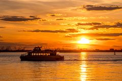 New York Water Taxi at sunset Stock Photo