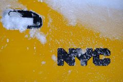 NYC logo on yellow cab door royalty free stock photography