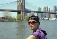 Brooklyn woman worried. Woman takes a lunch break at Brooklyn Bridge Park stock images