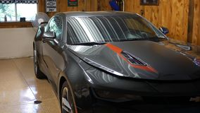 BROOKVILLE PA - Circa June 2018 - New Chevy Camaro in a mancave or auto repair shop stock video footage